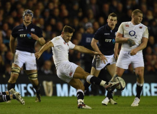 England's scrum half Danny Care kicks past England's captain and hooker Dylan Hartley (R) during the Six Nations international rugby union match between Scotland and England at Murrayfield in Edinburgh, Scotland on Febuary 6, 2016.