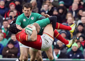 Wales' wing Tom James (C) is tackled by Ireland's wing Keith Earls during the Six Nations international rugby union match between Ireland and Wales at the Aviva Stadium in Dublin, Ireland, on February 7, 2016. / AFP / PAUL FAITH