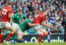 Ireland's prop Jack McGrath (L) tackles Wales' Bradley Davies during the Six Nations international rugby union match between Ireland and Wales at the Aviva Stadium in Dublin, Ireland, on February 7, 2016. / AFP / PAUL FAITH