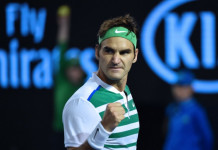 Switzerland's Roger Federer celebrates a point during his men's singles semi-final match against Serbia's Novak Djokovic on day eleven of the 2016 Australian Open tennis tournament in Melbourne on January 28, 2016. AFP PHOTO / SAEED KHAN-- IMAGE RESTRICTED TO EDITORIAL USE - STRICTLY NO COMMERCIAL USE / AFP / SAEED KHAN