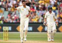 Mitchell Starc shows his discomfort after taking the wicket of Mitchell Santner of New Zealand. Photo: Getty Images