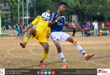 Sarasavi SC and Vikings SC player tussling for the ball