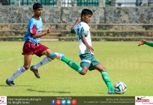 St.Henry's College player takes a kick against Dharmaraja College